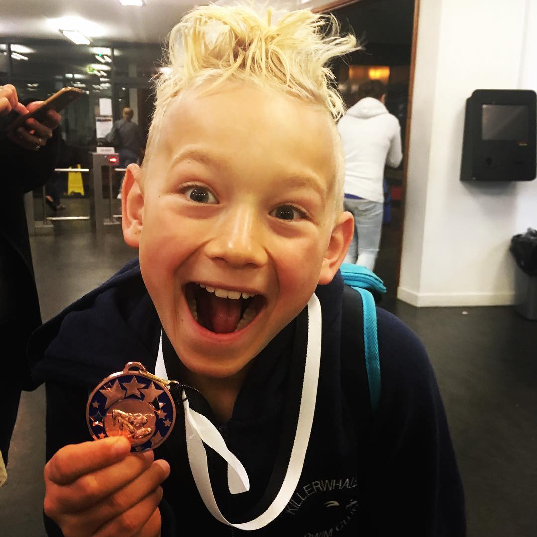 Cayden with his Swimming Medal