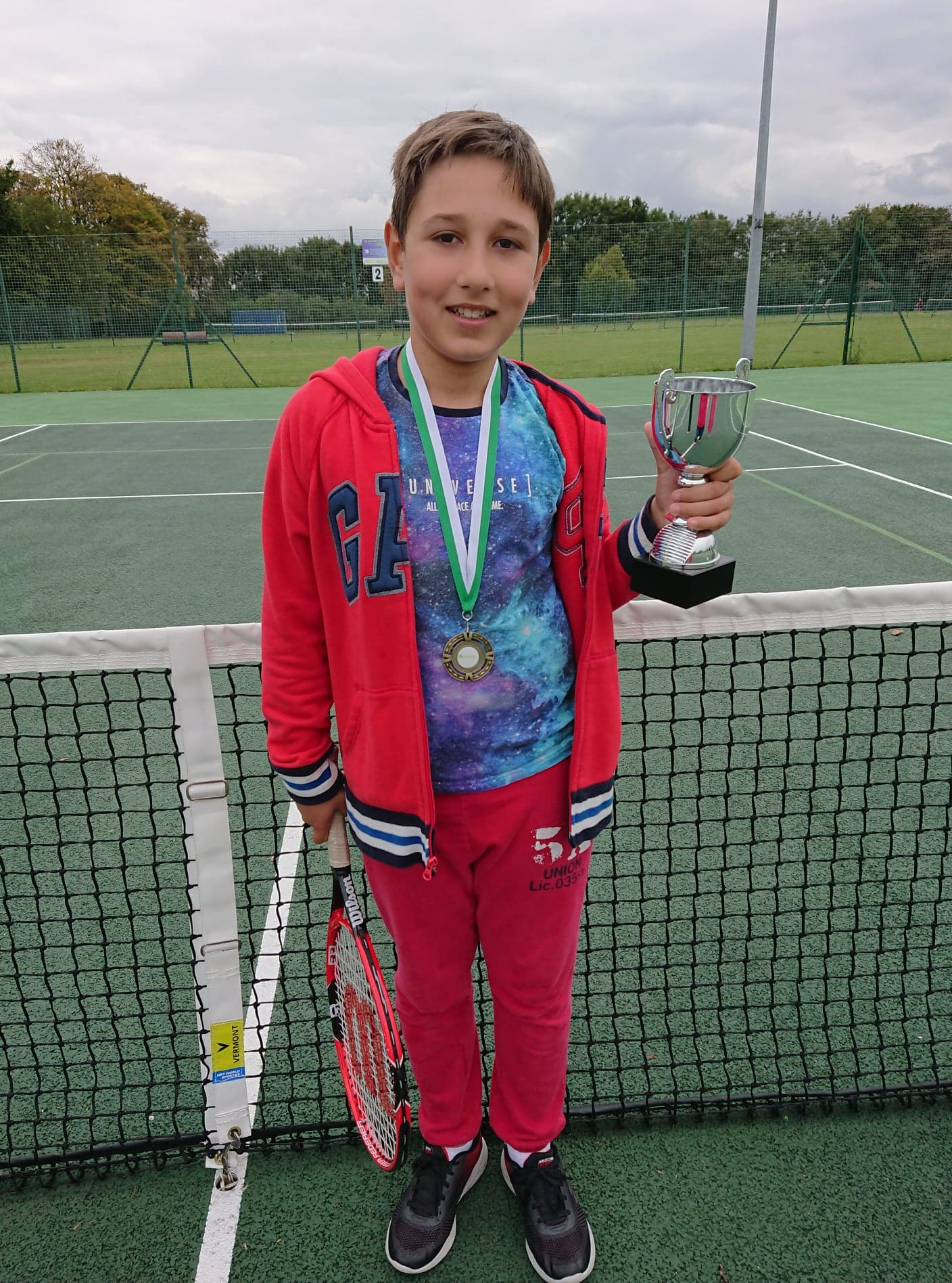 Max winning the local tennis championships